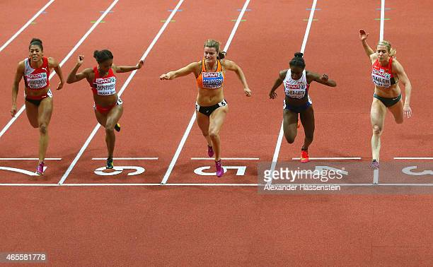 Dafne Schippers of Netherlands crosses the line to win gold ahead of silver medallist Dina AsherSmith of Great Britain Northern Ireland and bronze...