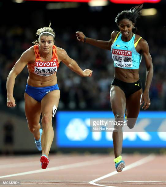 Dafne Schippers of the Netherlands and Shaunae Miller-Uibo of the Bahamas cross the finish line in the Women's 200 metres during day eight of the...