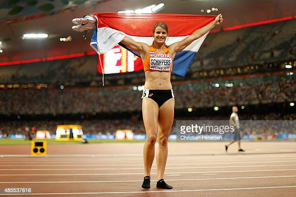 Dafne Schippers of the Netherlands celebrates after crossing the finish line to win gold in the Women's 200 metres final during day seven of the 15th...