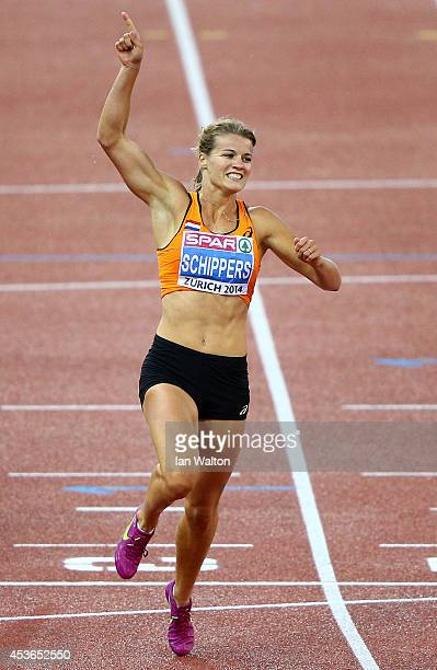 Dafne Schippers of the Netherlands celebrates after winning gold in the Women's 200 metres final during day four of the 22nd European Athletics...
