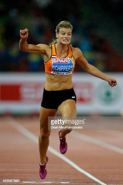 Dafne Schippers of the Netherlands celebrates victory in the Women's 100 metres final during day two of the 22nd European Athletics Championships at...