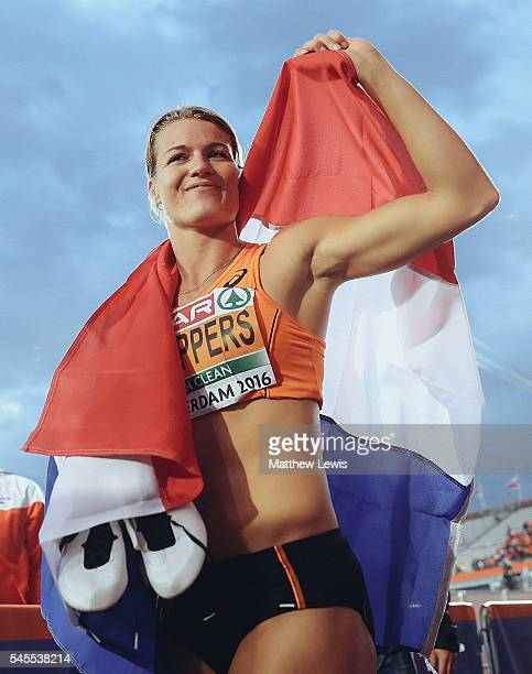 Dafne Schippers of the Netherlands celebrates winning the Womens 100m Final during day three of the 23rd European Athletics Championships at Olympic...