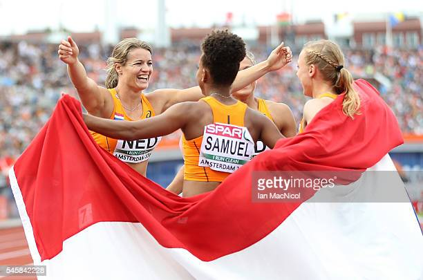 Dafne Schippers of The Netherlands celebrates with team mates after winning gold in the final of the womens 4x100m relay on day five of The 23rd...