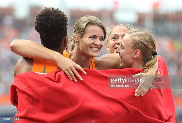 Dafne Schippers of The Netherlands celebrates with team mates after winning gold in the final of the womens 4x100m relay during day five of The...
