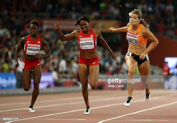 Dafne Schippers of the Netherlands crosses the finish line to win gold in the Women's 200 metres final during day seven of the 15th IAAF World...
