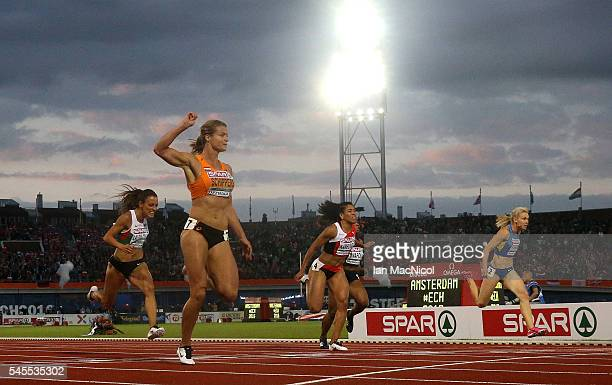 Dafne Schippers of The Netherlands crosses the finish line to win gold in the final of the womens 100m on day three of The 23rd European Athletics...