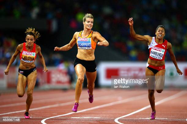 Dafne Schippers of the Netherlands crosses the line to claim victory in the Women's 100 metres final during day two of the 22nd European Athletics...