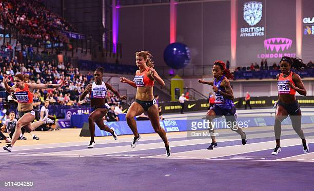 Dafne Schippers of the Netherlands crosses the line to win the the Women's 60 metres final ahead of Ewa Swoboda of Poland Dina AsherSmith of Great...