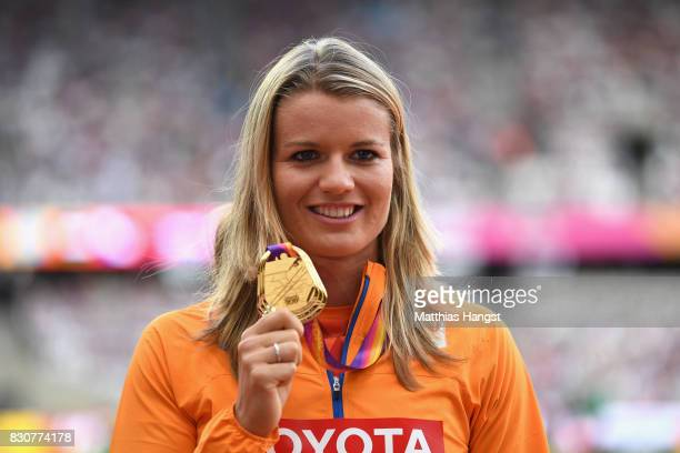 Dafne Schippers of the Netherlands, gold, poses with her medals for the Women's 200 metres during day nine of the 16th IAAF World Athletics...