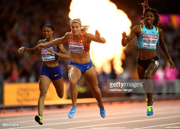 Dafne Schippers of the Netherlands, Marie-Josee Ta Lou of the Ivory Coast and Shaunae Miller-Uibo of the Bahamas cross the finish line in the Women's...