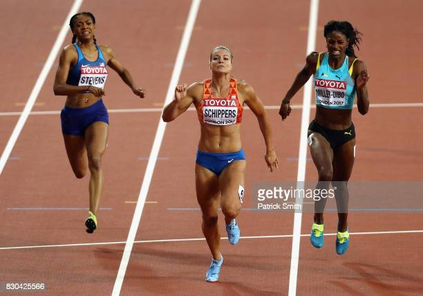 Dafne Schippers of the Netherlands, Shaunae Miller-Uibo of the Bahamas and Deajah Stevens of the United States race to the finish line in the Women's...