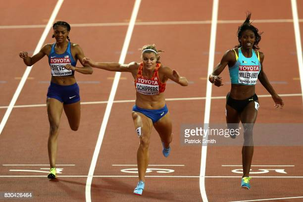 Dafne Schippers of the Netherlands, Shaunae Miller-Uibo of the Bahamas and Deajah Stevens of the United States cross the finish line in the Women's...