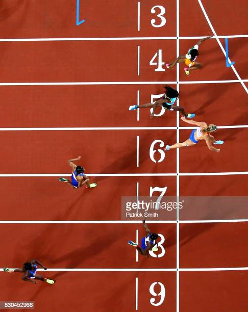 Dafne Schippers of the Netherlands Shaunae MillerUibo of the Bahamas and MarieJosee Ta Lou of the Ivory Coast cross the finish line in the Women's...
