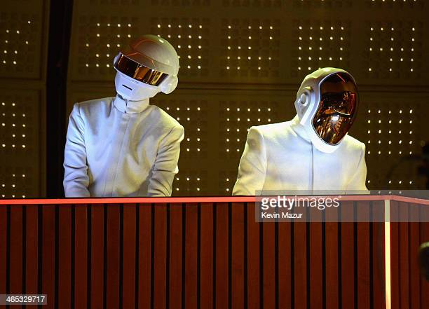 Daft Punk perform onstage during the 56th GRAMMY Awards at Staples Center on January 26 2014 in Los Angeles California