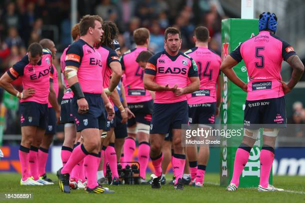 Dafydd Hewitt Matthew Rees and Filo Paulo of Cardiff Blues look on after conceding a try during the Heineken Cup Pool Two match between Exeter Chiefs...