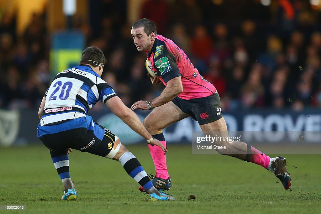 Dafydd Hewitt (R)of Cardiff Blues runs at Guy Mercer (L) of Bath during the LV Cup match between Bath and Cardiff Blues at the Recreation Ground on January 25, 2014 in Bath, England.