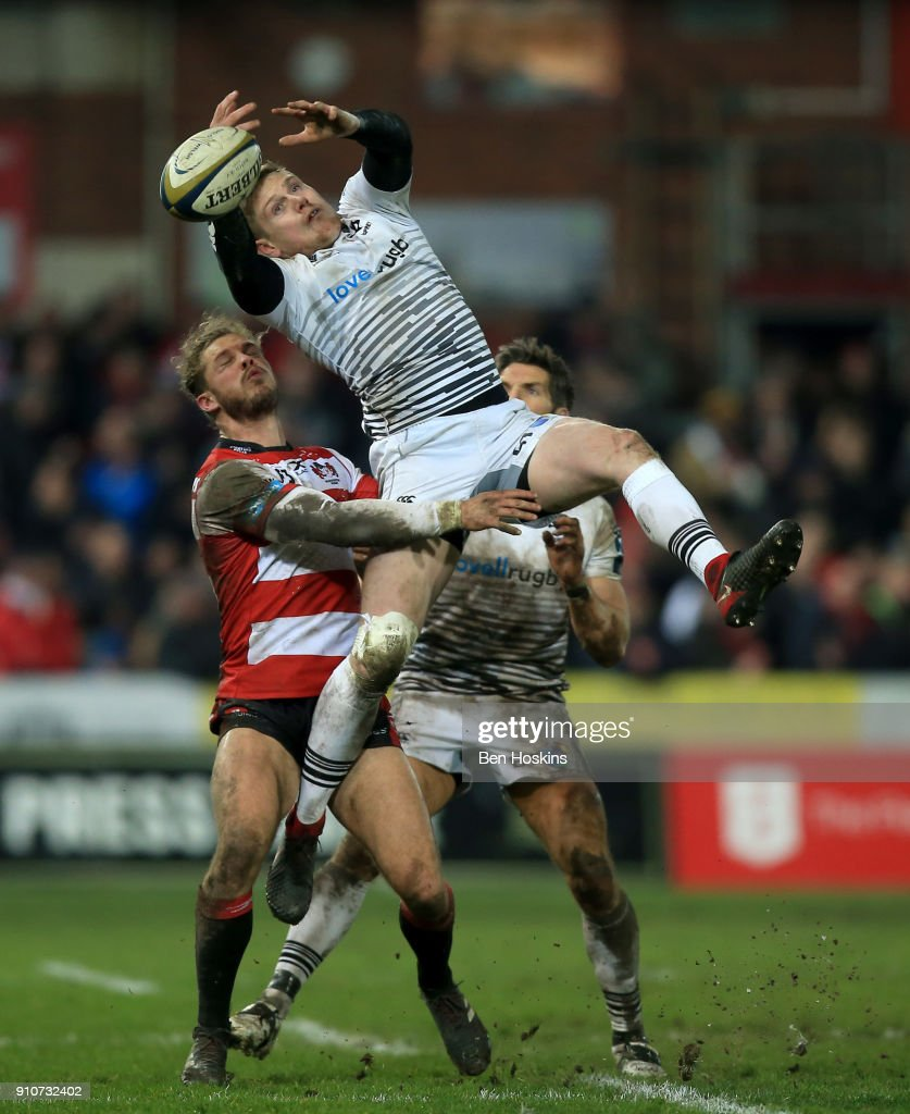 Dafydd Howells of Ospreys beats Henry Purdy of Gloucester to the ball during the Anglo-Welsh Cup match between Gloucester Rugby and Ospreys at Kingsholm Stadium on January 26, 2018 in Gloucester, England.