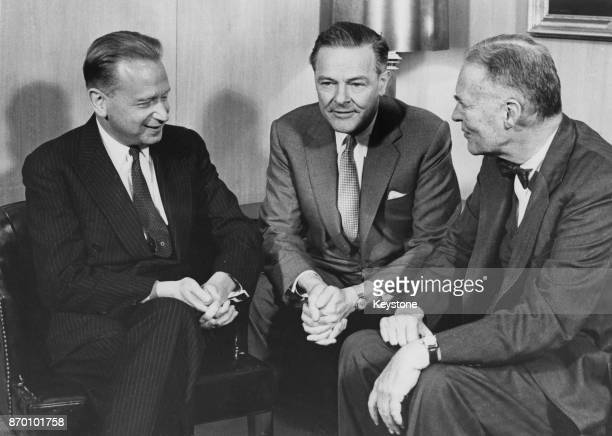 Dag Hammarskjöld the SecretaryGeneral of the United Nations holds a meeting in the Diplomatic Section Room of the State Department in Washington DC...