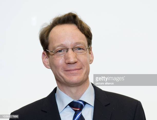 Dag Nikolaus Hasse, Institute of Philosophy at the Julius Maximilians University Wuerzburg, poses after winning an award during the Gottfried Wilhelm...