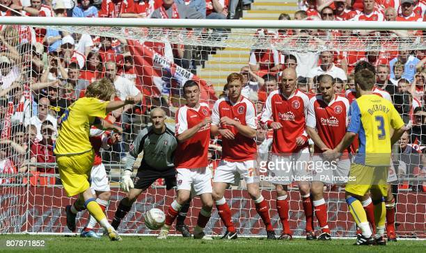 Dagenham & Redbridge's Danny Green has a free kick which is saved by Rotherham United goalkeeper Andy Warrington