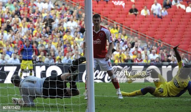 Dagenham & Redbridge's Joshua Scott watches as teammate Jon Nurse scores his sides third goal of the game