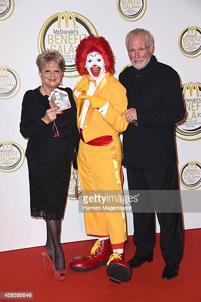 Dagmar Frederic and her husband Klaus Lenk with Ronald McDonald attend the McDonald's charity gala on November 7 2014 in Weissach near RottachEgern...