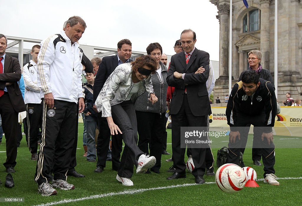 Dagmar Freitag, chairlady of the sports commission Bundestag handicaped with a mask, kicks a penalty on the 'Day of Blind Football�' in front of the Reichstag on May 20, 2010 in Berlin, Germany.