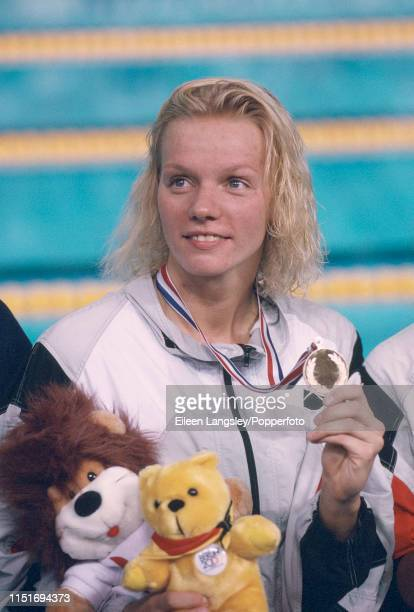 Dagmar Hase representing Germany poses with her gold medal after a freestyle event during the 1993 European Aquatics Championships at the Ponds Forge...