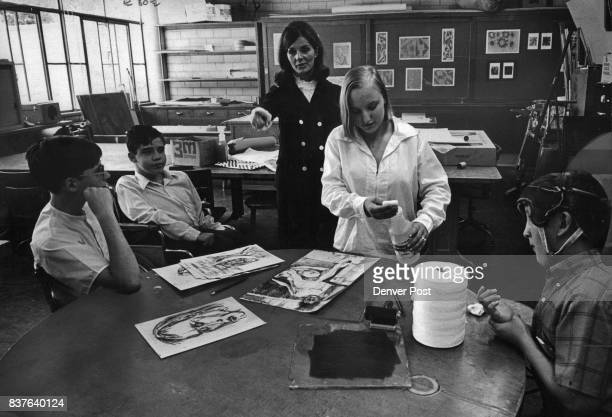 Dagmar Havlicek a 10th grader at Boettcher School prepares to wash ink from the paper after the first printing The students are participating in a...