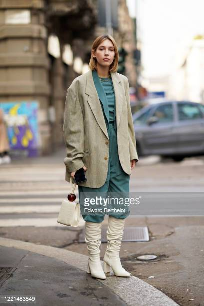 Dagmara Jarzynka wears an oversized blazer jacket, a green top, a white bag, leather pointy boots, outside Calcaterra, during Milan Fashion Week...
