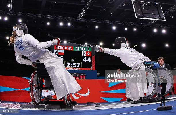 Dagmara WitosEze of Poland in action with Pui Shan Fan of Hong Kong China during the Women's Team Wheelchair Fencing on day 9 of the London 2012...