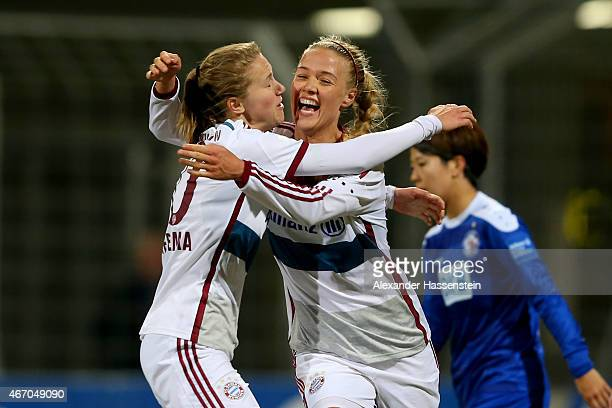 Dagny Brynjarsdottir of Muenchen celebrates scoring the opening goal with her team mate Vivianne Miedema during the Allianz FrauenBundesliga match...