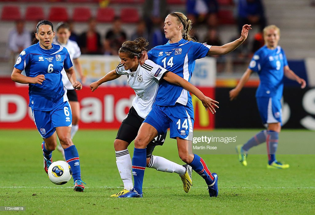 Dagny Brynjatsdottir (R) of Iceland and Lena Lotzen (L) of Germany battle for the ball during the UEFA Women's Euro 2013 group B match between Iceland and Germany at Vaxjo Arena on July 14, 2013 in Vaxjo, Sweden.