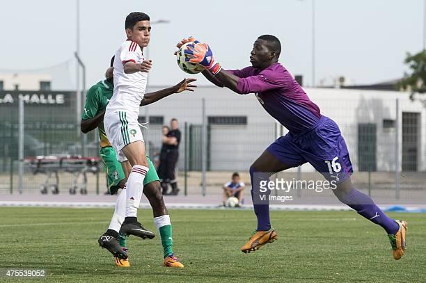 Dagou Willie Britto of Cote d'Ivoire U21 Achraf Bencharki of Morocco U21 goalkeeper Drissa Bamba of Cote d'Ivoire U21 during the Festival...