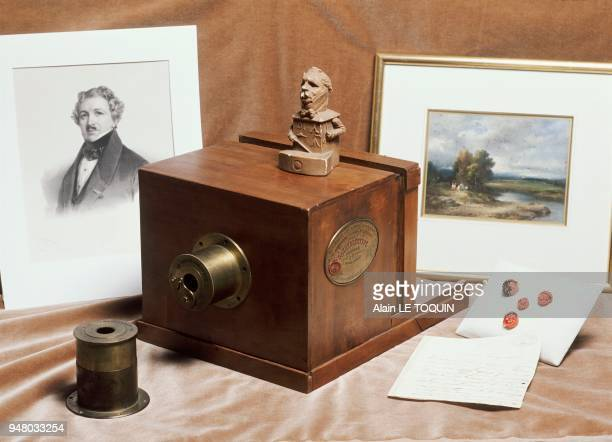 A daguerreotype camera made by Alphonse Giroux in Paris in 1839 and a portrait of Louis Jacques Mandé DAGUERRE are exhibited by the French Company of...