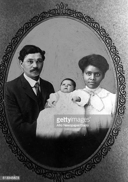 Daguerreotype of African-American family holding a baby in turn-of-the-century America, 1890.