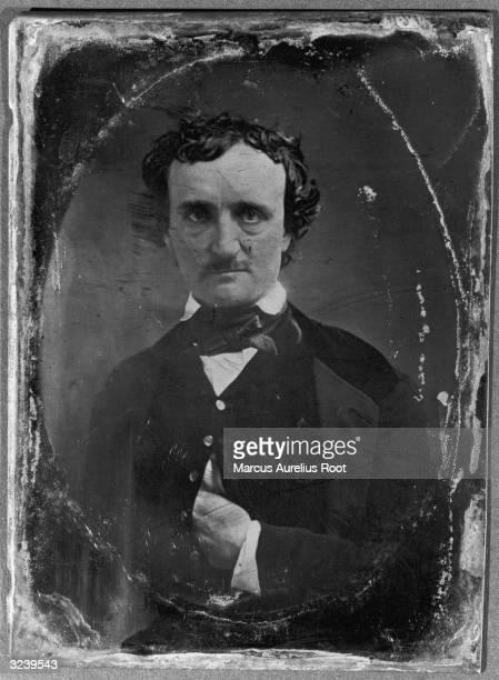 A daguerreotype portrait of American author poet and critic Edgar Allan Poe placing one hand inside his vest