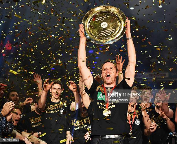 Dagur Sigurdsson head coach of Germany celebrates with the winners trophy at the European Handball Champions winners party at Max Schmeling Halle on...