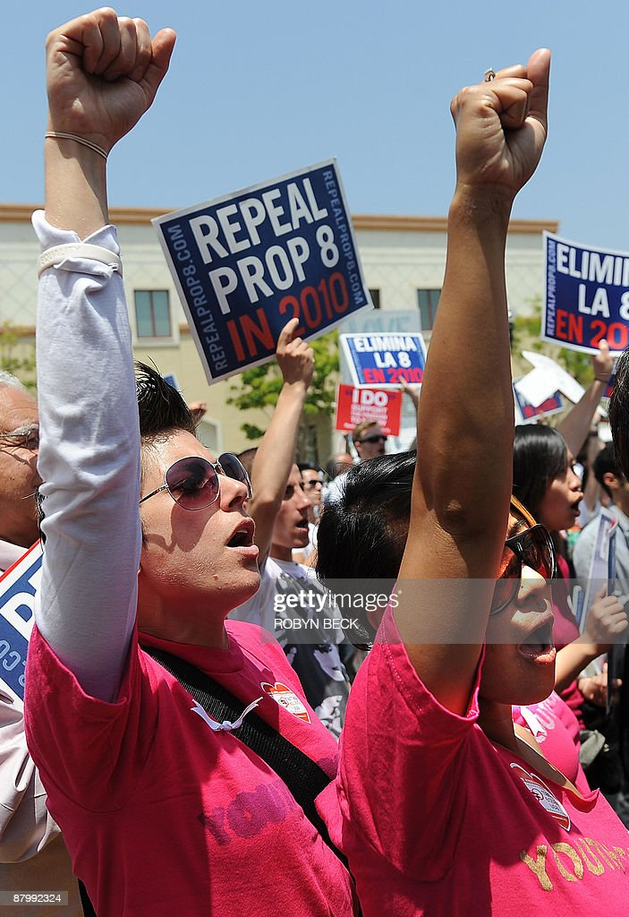 Dahlia Ferlito, 28, (L) and her wife Antoinette Reyes, 27, (R), chant with other demonstrators at a protest rally outside the Los Angeles County Marriage License Office in Los Angeles, California on May 26, 2009, following the California Supreme Court decision to uphold Proposition 8 which outlawed gay marriage.