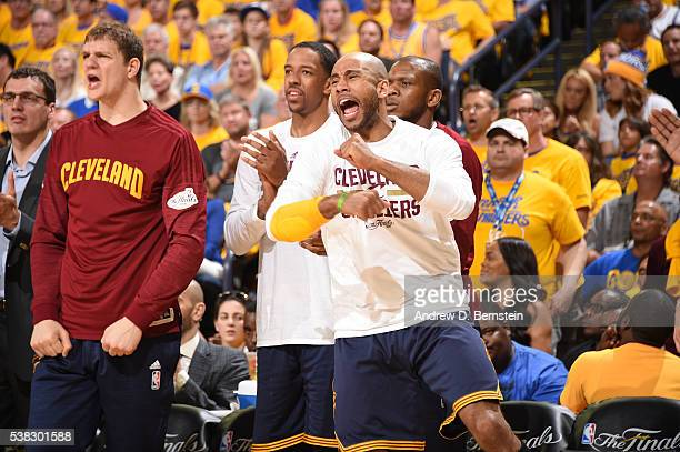 Dahntay Jones and the Cleveland Cavaliers bench celebrates during the game against the Golden State Warriors in Game Two of the 2016 NBA Finals on...