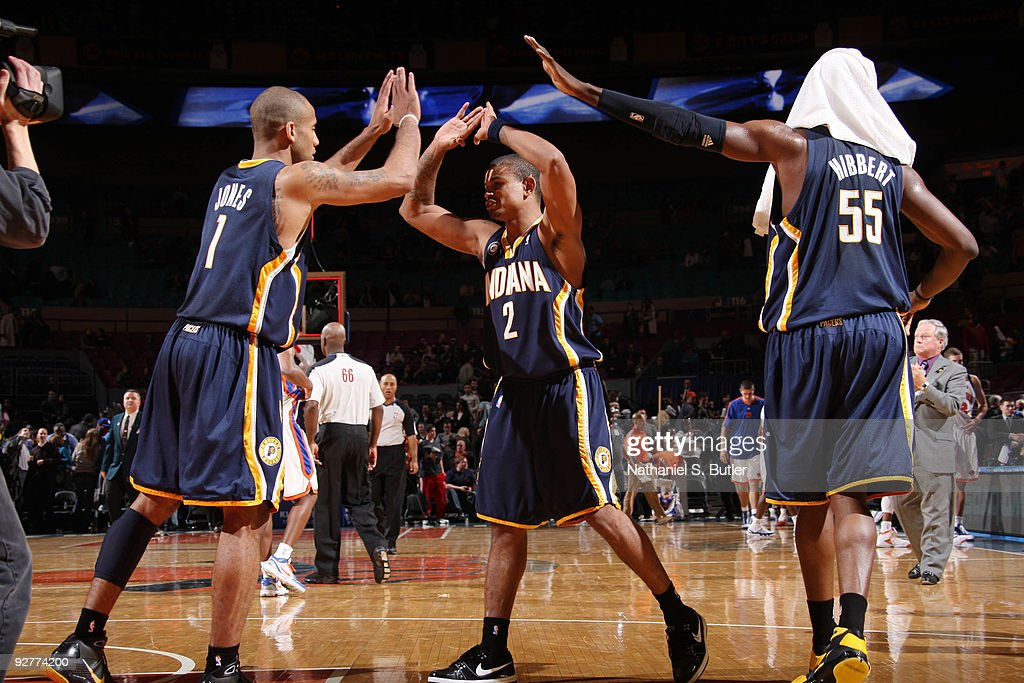 Dahntay Jones #1, Earl Watson #2 and Roy Hibbert #55 of the Indiana Pacers celebrate their victory against the New York Knicks on November 4, 2009 at Madison Square Garden in New York City.