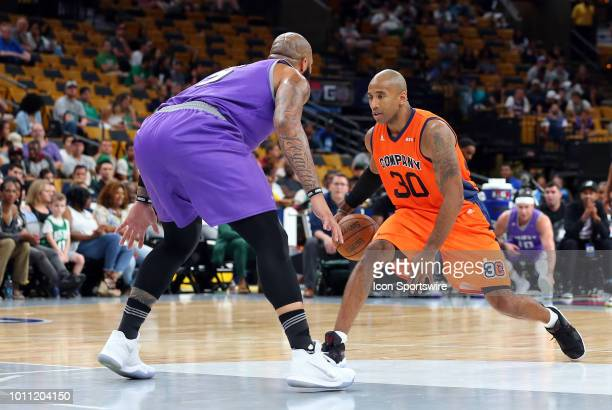 Dahntay Jones of 3's Company and Carlos Boozer of Ghost Ballers in action during week 7 of the BIG3 basketball league on August 3 at TD Garden in...