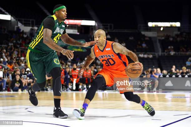 Dahntay Jones of 3's Company dribbles against Will McDonald of the Ball Hogs during week four of the BIG3 three on three basketball league at Dunkin'...