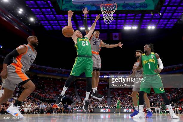 Dahntay Jones of 3's Company knocks the ball away from Brian Scalabrine of the Ball Hogs during BIG3 Week Four at Little Caesars Arena on July 13...