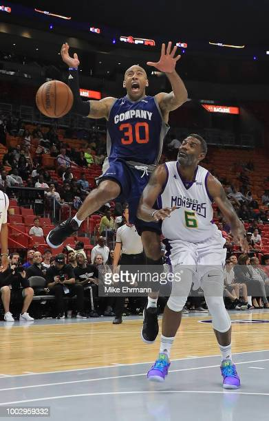 Dahntay Jones of 3's Company loses the ball under pressure from Qyntel Woods of 3 Headed Monsters during a game during Big 3Week Five at American...