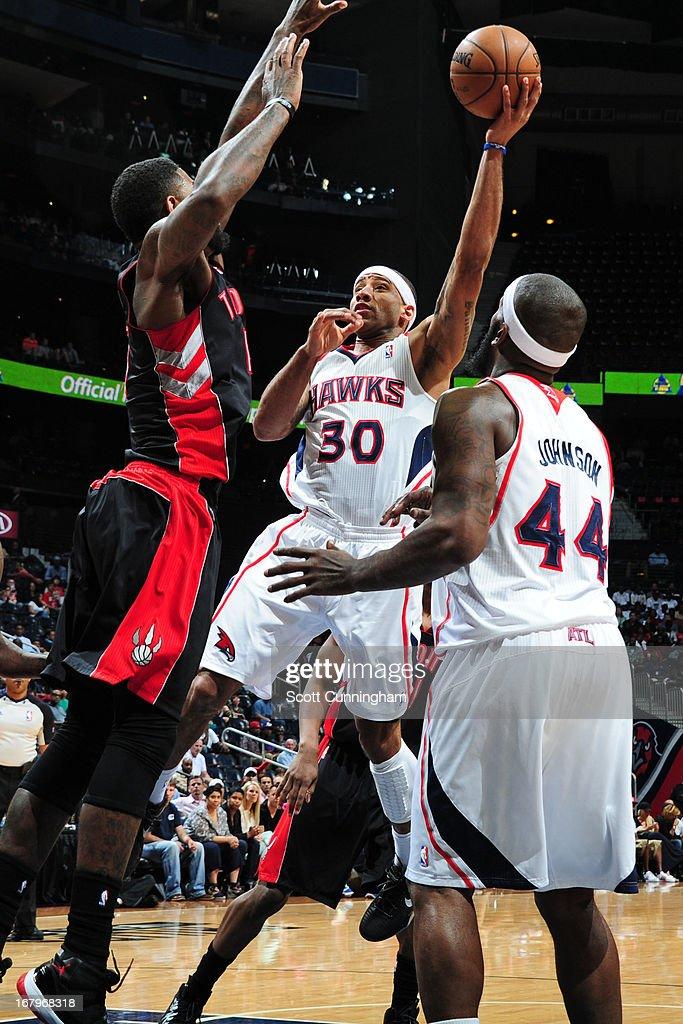 Dahntay Jones #30 of the Atlanta Hawks drives to the basket against the Toronto Raptors on April 16, 2013 at Philips Arena in Atlanta, Georgia.
