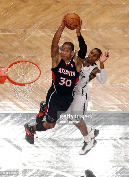 Dahntay Jones of the Atlanta Hawks scores two in the second half against the Brooklyn Nets at the Barclays Center on March 17 2013 in New York City...