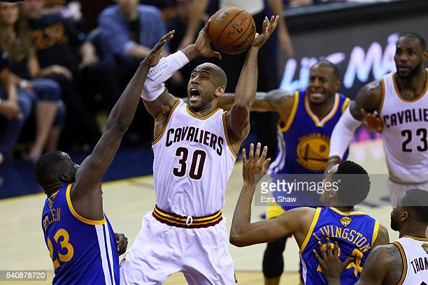 Dahntay Jones of the Cleveland Cavaliers drives to the basket against Draymond Green of the Golden State Warriors in the first half in Game 6 of the...