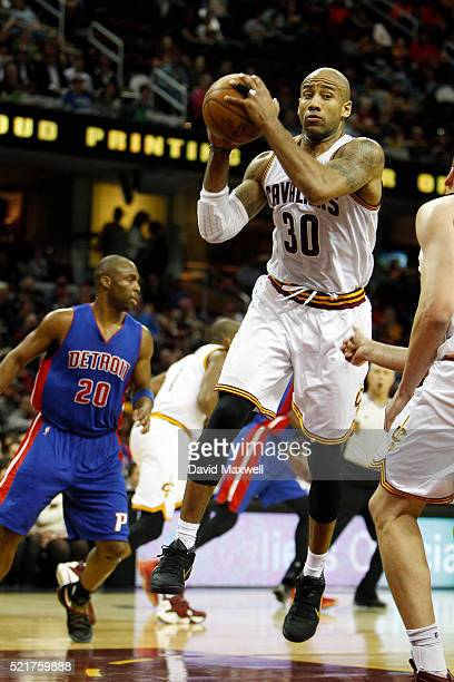 Dahntay Jones of the Cleveland Cavaliers grabs a rebound against the Detroit Pistons at Quicken Loans Arena on April 13 2016 in Cleveland Ohio The...