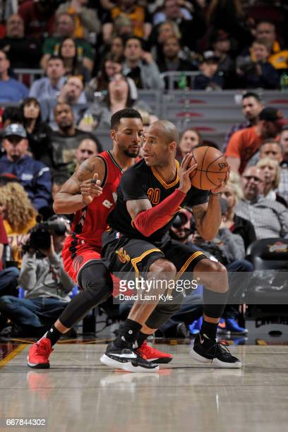 Dahntay Jones of the Cleveland Cavaliers looks to drive while defended by Norman Powell of the Toronto Raptors on April 12 2017 at Quicken Loans...